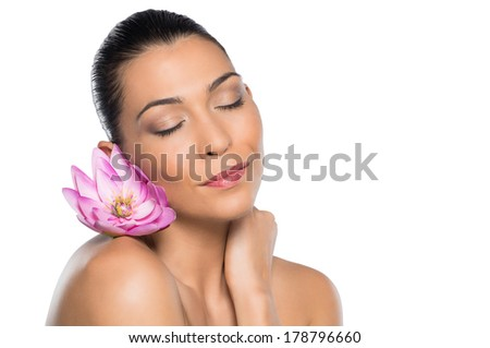Young Beautiful Woman Relaxing With Lotus Flower On Her Shoulder And Eyes Closed Isolated On White Background