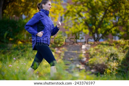 Young Beautiful Woman Running in the Park. Active Lifestyle
