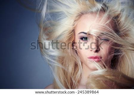young beautiful woman. Sexy blond girl. Beauty salon.Haircare - stock photo