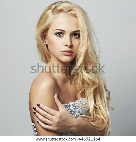 young beautiful woman.Sexy Blond girl.Curly hairstyle - stock photo