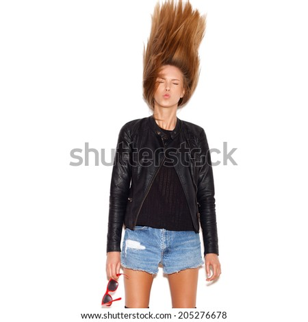 Young beautiful woman shaking her hair . White background, not isolated - stock photo
