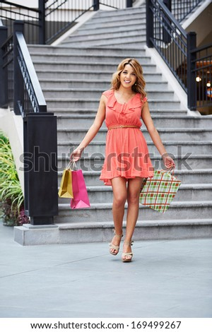 Young beautiful woman shopping at the mall