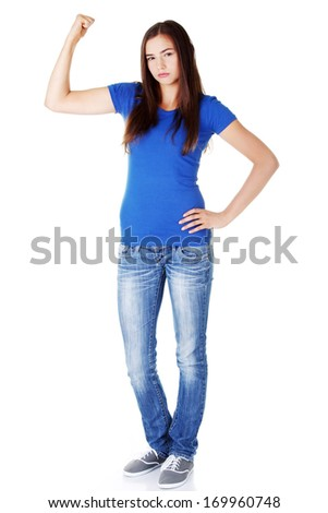Young beautiful woman showing her strenght and muscle. Isolated on white. - stock photo