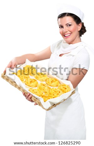 young beautiful woman showing homemade fresh pasta on white - stock photo