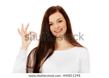 Young beautiful woman showing OK sign