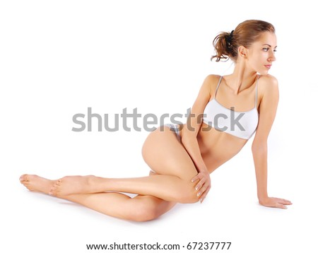 Young beautiful woman sitting on a floor - stock photo