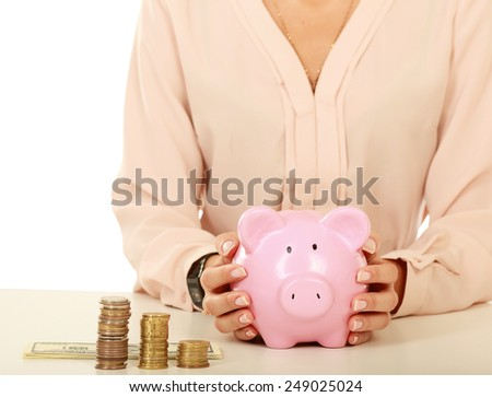 Young beautiful woman sitting with piggy bank , isolated on white background