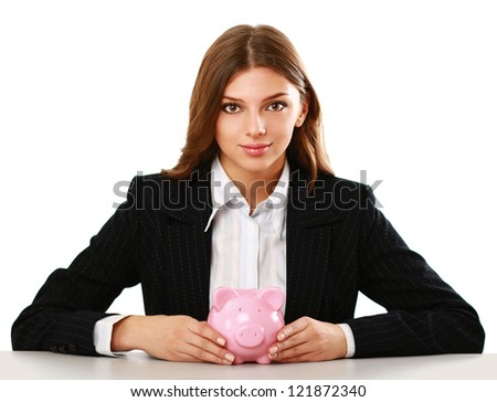 Young beautiful woman sitting with piggy bank (money box), isolated on white background - stock photo