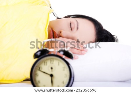 Young beautiful woman sleeping in bed. - stock photo