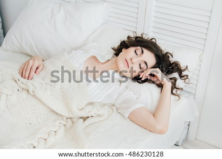 Young beautiful woman sleeping in bed in the morning.