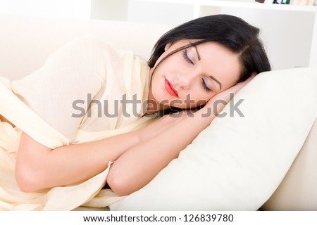 young beautiful woman sleeping on the couch