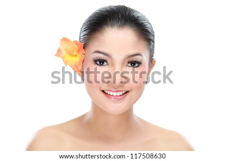 Young beautiful woman smiling with flower isolated on white background - stock photo