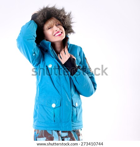 Young beautiful woman snowboarder looking at camera, smiling. - stock photo