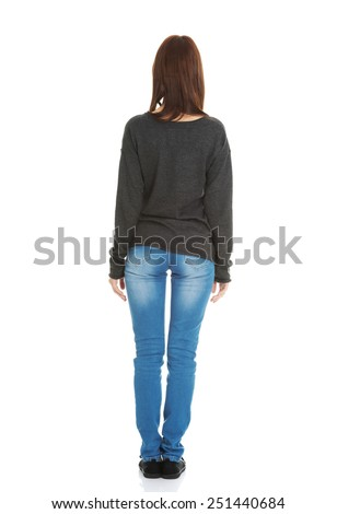 Young beautiful woman standing backside - stock photo