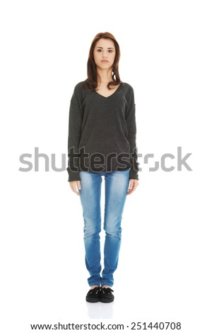 Young beautiful woman standing from the front - stock photo