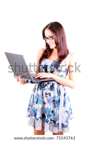 Young beautiful woman standing holding a laptop