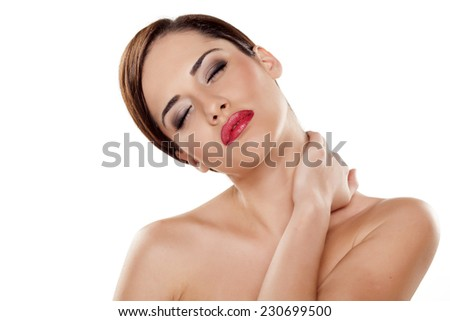 young beautiful woman stretch her neck and massaged it with her hand - stock photo