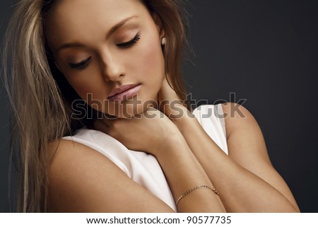 Young beautiful woman studio isolated. Sensual model fashion posing. Beauty shoot of attractive girl. - stock photo
