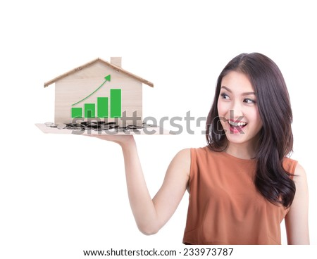 young beautiful woman surprise a house prices high graph on hand