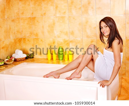 Young beautiful woman take bubble  bath. - stock photo