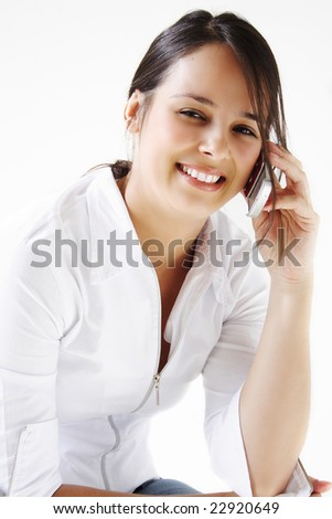 Young beautiful woman talking and smiling on cellphone. - stock photo