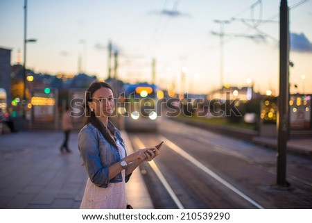 Young beautiful woman talking on her phone - stock photo