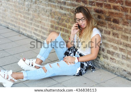 Young beautiful woman talking on her phone
