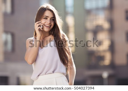 Young Beautiful Woman Talking On Mobile Phone Outdoor.