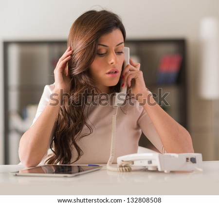 Young Beautiful Woman Talking On Telephone, Indoors - stock photo