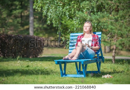 Young beautiful woman tanning on the sun lounger - stock photo