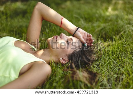 Young beautiful woman (teen girl) looking to side - outdoor in nature