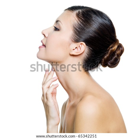 Young beautiful woman touching by fingers her neck - isolated on white background - stock photo