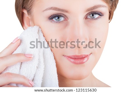 Young beautiful woman using a cotton towel to remove her makeup. Isolated on white background