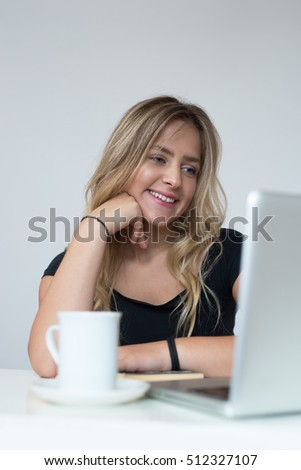 Young beautiful woman using a laptop computer