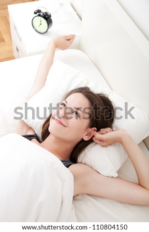 Young beautiful, woman waking up fully rested. - stock photo
