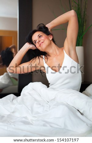 Young beautiful, woman waking up happy and rested.