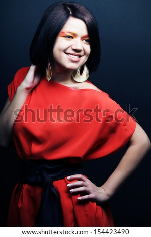 Young beautiful woman wearing a red dress  - stock photo