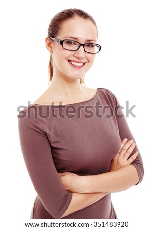Young beautiful woman wearing black glasses and brown dress standing with crossed arms and smiling isolated on white background