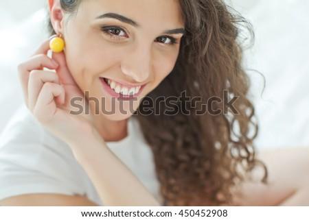 Young beautiful woman wearing earrings handmade jewelry - stock photo