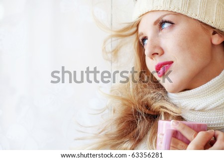 Young beautiful woman wearing winter clothing drinking hot coffee - stock photo