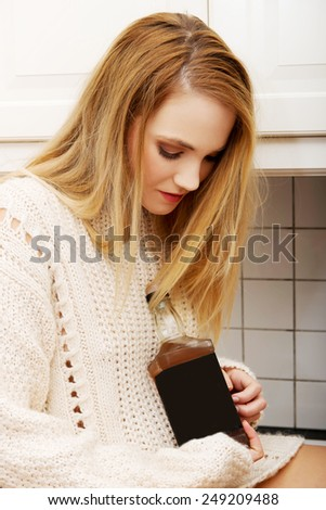 Young beautiful woman with a bottle of alcohol. - stock photo