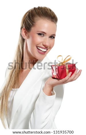Young beautiful woman with a gift on a white background - stock photo