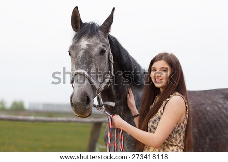 Young beautiful woman with a horse. - stock photo