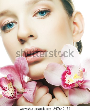 young beautiful woman with a orchid  flowers. - stock photo