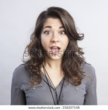 young beautiful woman with a surprised face expression