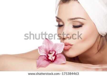 young beautiful woman with a towel on her head and kissing orchid