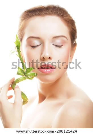 young beautiful woman with bamboo