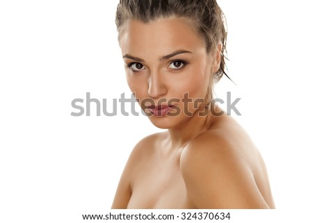 young beautiful woman with bare shoulders posing on a white - stock photo