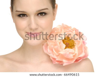 Young beautiful woman with big pink flower - stock photo