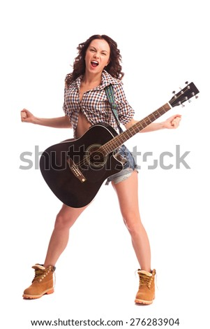 Young beautiful woman with black acoustic guitar over white background  - stock photo